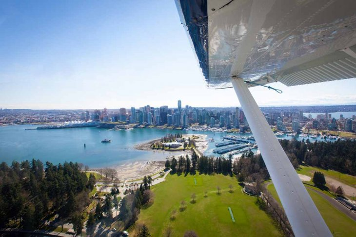 Seaplane over coal harbour, Vancouver